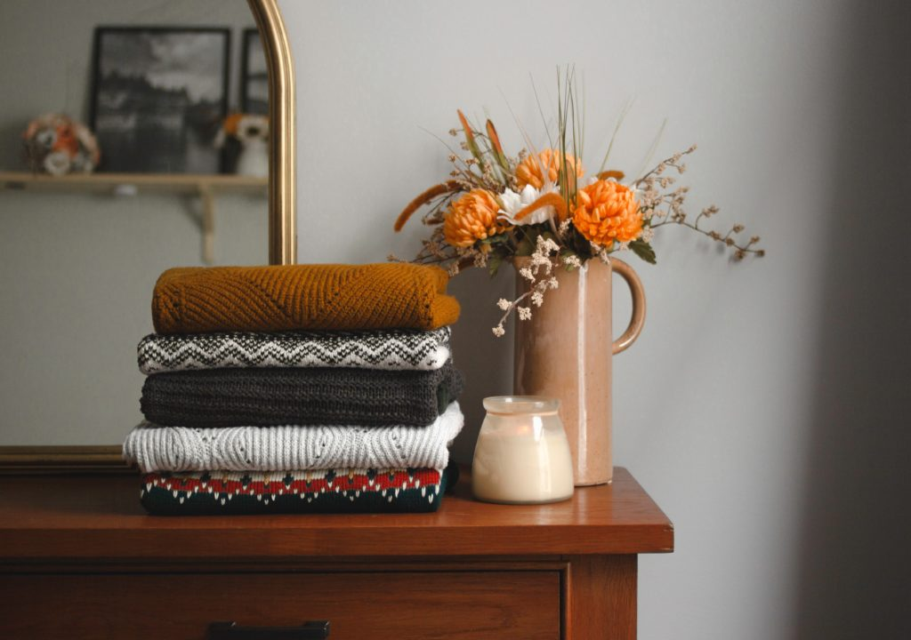 Stack of sweaters on dresser